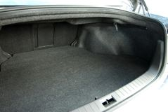 Empty car trunk. Empty trunk of the large white sedan Royalty Free Stock Images