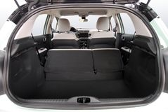 Empty trunk of the small car. Car trunk with rear seats folded Royalty Free Stock Photos
