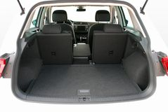 Empty trunk of the suv. Car trunk with partially folded rear seats Stock Photos