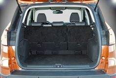 Empty trunk of the suv. Empty trunk of the small orange suv Royalty Free Stock Photography