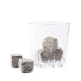 Empty tumbler filled with stones Royalty Free Stock Photography