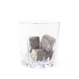 Empty tumbler filled with stones Stock Photography