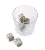 Empty tumbler filled with stones Stock Image