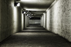 Empty tunnel at night. With lights stock image
