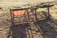 Empty two beach chairs vintage color. Tone summer holiday concept Stock Photo