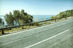 Empty two lane asphalt road highway vanishing in perspective.  Royalty Free Stock Image