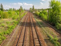 Empty railway perspective view for transporting every day people different distances. Empty two lines railway perspective view. Going distances and come back to stock photos