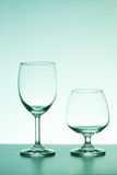 Empty two wine glass green lighting on white background Royalty Free Stock Photography