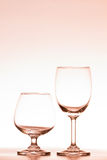 Empty two wine glass orange lighting on a white background Stock Photo