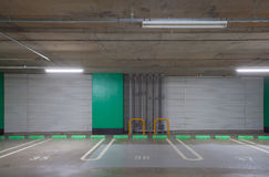 Empty underground car parking lot Stock Images