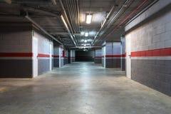 Empty underground garage. In a residential building Stock Photos