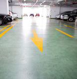 Empty underground garage. With arrow leading to go to car park Royalty Free Stock Image