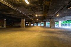 Empty underground garage, cars parking. With orange neon light Stock Photography