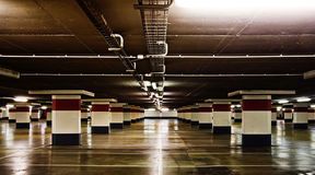 Empty underground parking. Reflections on the floor Stock Photography