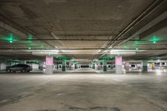 Empty underground parking background with copy space. At shopping mall Royalty Free Stock Photo