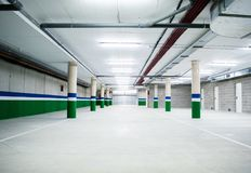 Empty underground parking garage Stock Photos