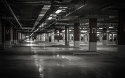 Empty underground parking garage. Industrial background Stock Photo