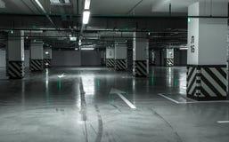 Empty underground parking garage. Industrial background Stock Photos