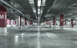 Empty underground parking garage. Industrial background Stock Photo