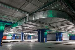 Empty underground parking or garage interior, city car infrastructure. Toned Royalty Free Stock Photography