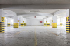Empty underground parking garage Stock Images