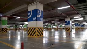 Empty Underground parkingfor cars and many free places.  stock footage