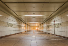 Empty underground passage at night Stock Photo