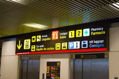 Madrid/Spain – 03.03.2019 :    Madrid underground tunnel airport informations signs. Empty underground tunnel of Madrid Airport  where passengers can see stock photography