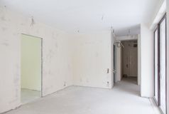 Empty unfinished apartment. Empty interior of unfinished apartment with cables sticking from walls Royalty Free Stock Images
