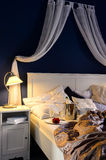 Empty unmade luxury bed romantic feeling champagne Royalty Free Stock Photo