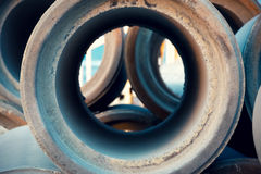 Empty and unused sewage pipes close up Royalty Free Stock Image