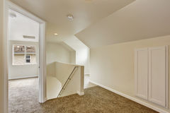 Empty upstairs hallway with stairs Royalty Free Stock Image