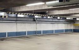 Empty urban parking interior, concrete walls. Empty underground parking interior, concrete walls and floor Stock Photos
