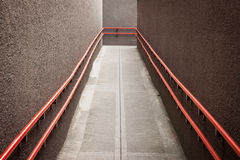 Empty urban underpass. With orange handrails royalty free stock photos