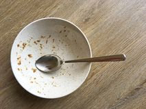 Dirty Cereal Bowl with Spoon Royalty Free Stock Photography