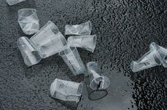 Empty used cup glasses on the street Stock Image