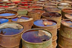 Empty used toxic rusty drums. Some used toxic rusty drums. Close up royalty free stock photo