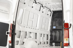 Empty van with open doors ready to be loaded Royalty Free Stock Images