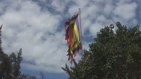 A empty variegated flag fluttering in the wind. Empty variegated flag fluttering in the wind stock video footage