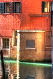 Empty Venice Canal a Sliver of light. An empty canal in Venice with a sliver of sun light royalty free stock photo