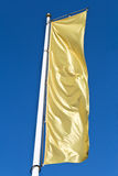 Empty vertical banner golden flag Stock Image