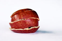 Empty vessel. Peeled apple skin holding form Royalty Free Stock Images