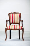 Empty vintage arm chair Royalty Free Stock Photo