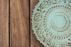 Empty vintage blue plate on wood table top view, flat lay Royalty Free Stock Image