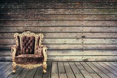 Empty vintage chair in grunge old wooden room Royalty Free Stock Photography