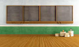 Empty vintage classroom. With big  blackboard and stacks of books - rendering Royalty Free Stock Image