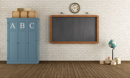 Empty Vintage classroom. Vintage classroom with blackboard and wooden cabinets - rendering Stock Image