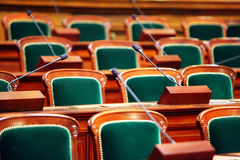 Empty vintage congress hall. With seats and microphones Stock Images