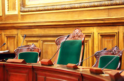 Empty vintage court's room. With table,chairs and microphones stock photos