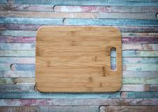 Empty vintage cutting board on planks food background concept stock photo